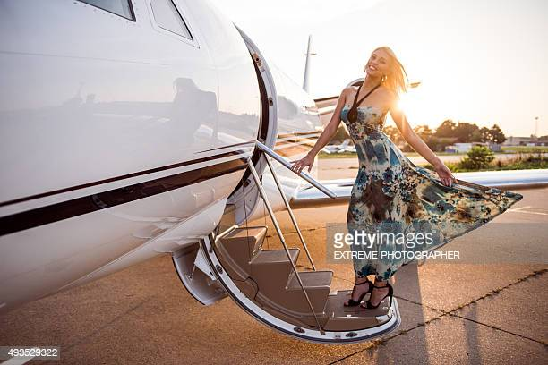 Blonde woman entering private airplane