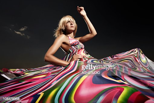 Blonde woman in wild patterned dress : Stock Photo