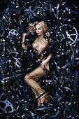 Blonde woman is lying on film reels