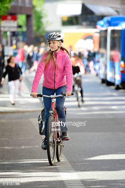 Blonde woman on bike and bus