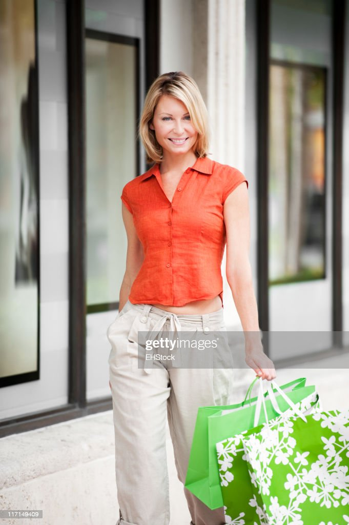 Blonde Woman Shopping with Bags : Stock Photo