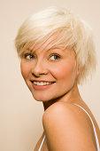 Blonde woman smiling.