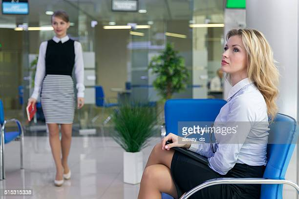 Blonde woman waiting in client service area