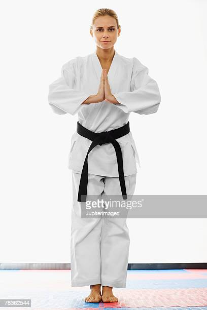 Blonde woman wearing karate uniform