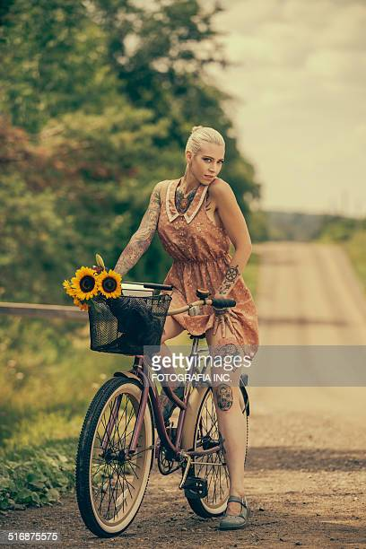 Blonde woman with cruiser bicycle