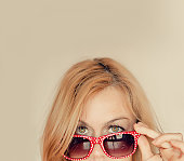 Blonde woman with red glasses