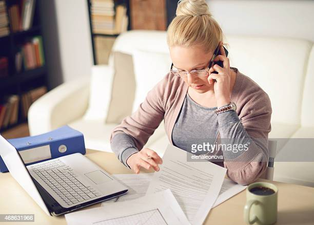 blonde woman working at home