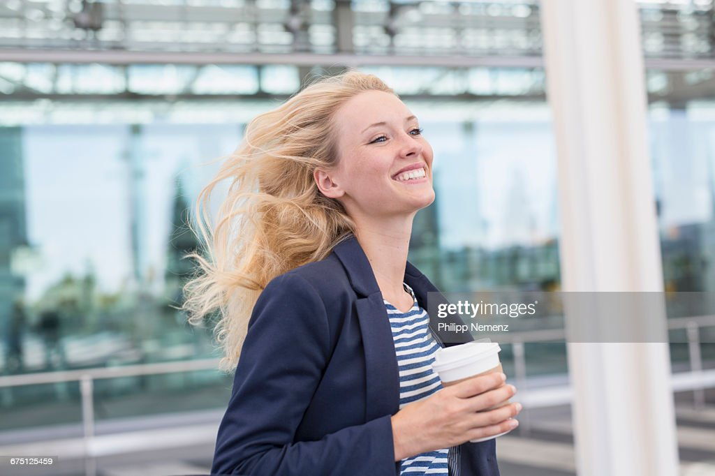 blonde women running with coffee : Stock Photo
