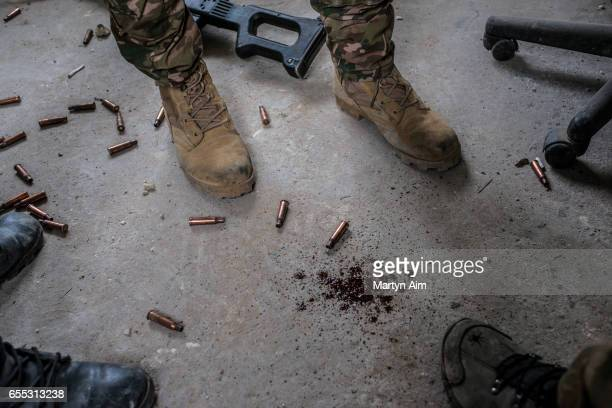 Blood a machinegun and bullets on the ground during fierce fighting between Iraqi forces and Islamic State militants in Bab alTob a neighbourhood in...