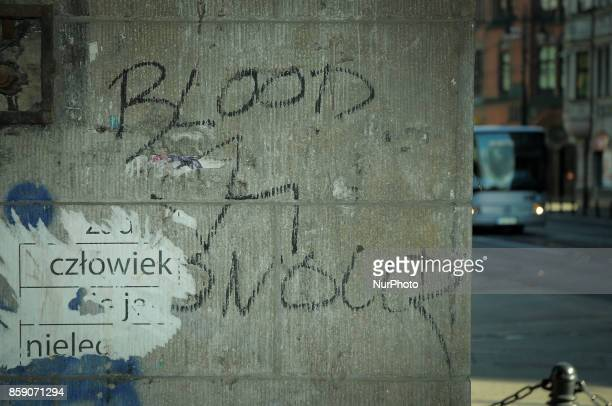 Blood and honour the name of a neo Nazi music promotion network and political group is seen written on a wall in the center of the city on October 8...