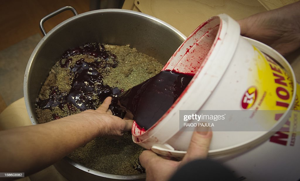 Blood is poured during the preparation of Estonian blood sausage in Tallinn, Estonia, on December 15, 2012.As Christmas looms, residents of the Baltic state of Estonia are bracing to wolf down tonnes of blood sausage, a staple of their holiday table.