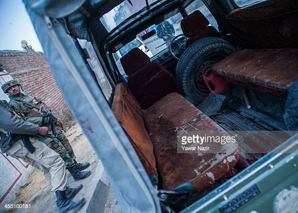 Blood of an Indian paramilitary officer lies on the floor of an Indian Army vehicle after suspected militants killed him and wounded another on the...