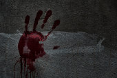 Blood of hand on a wall in an abandoned house them.The story about the murder.Background operators in Halloween festivities.