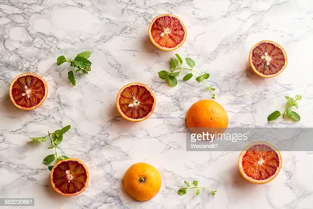Blood orange and mint leaves on marble