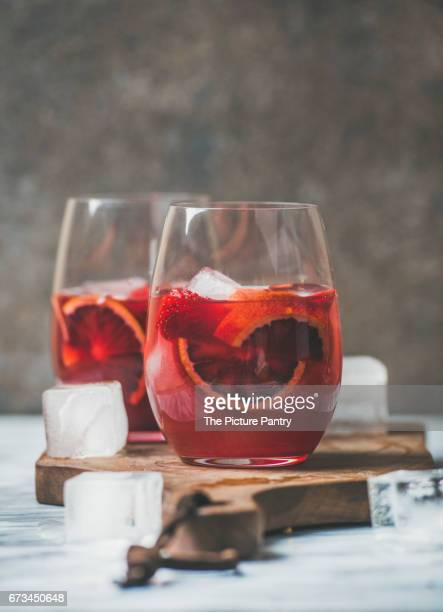 Blood orange and strawberry summer Sangria in glasses with ice