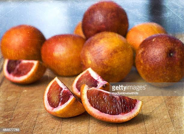 Blood Orange Slices and Whole Blood Oranges
