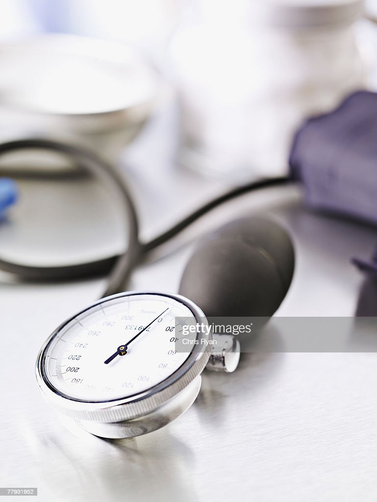 Blood pressure device on table : Stock Photo