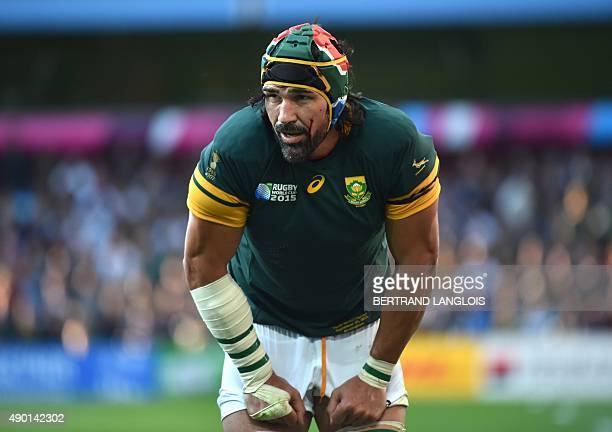 Blood runs down the face of South Africa's lock Victor Matfield during the Pool B match of the 2015 Rugby World Cup between South Africa and Samoa at...