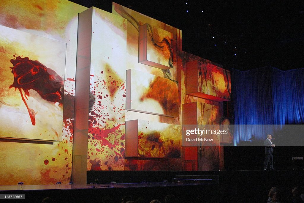 Blood spatters are projected onstage as Sony Computer Entertainment America President and CEO Jack Trentton (R) introduces a violent game at the Sony press conference on the eve of the Electronic Entertainment Expo (E3) on June 4, 2012 in Los Angeles, California. E3 is the most important yearly trade show the $78.5 billion videogame industry.