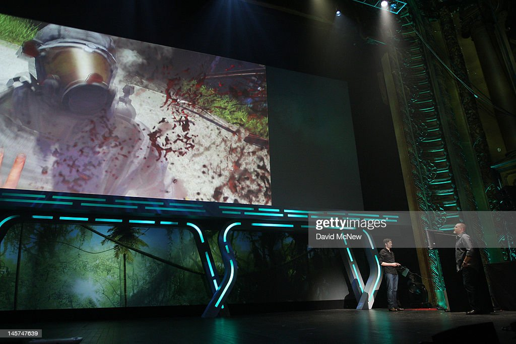 Blood splatters as a man is stabbed to death on screen as producer Dan Hay (R) demonstrates the game Far Cry 3 at the Ubisoft press conference on the eve of the Electronic Entertainment Expo (E3) on June 4, 2012 in Los Angeles, California. E3 is the most important yearly trade show the $78.5 billion videogame industry.