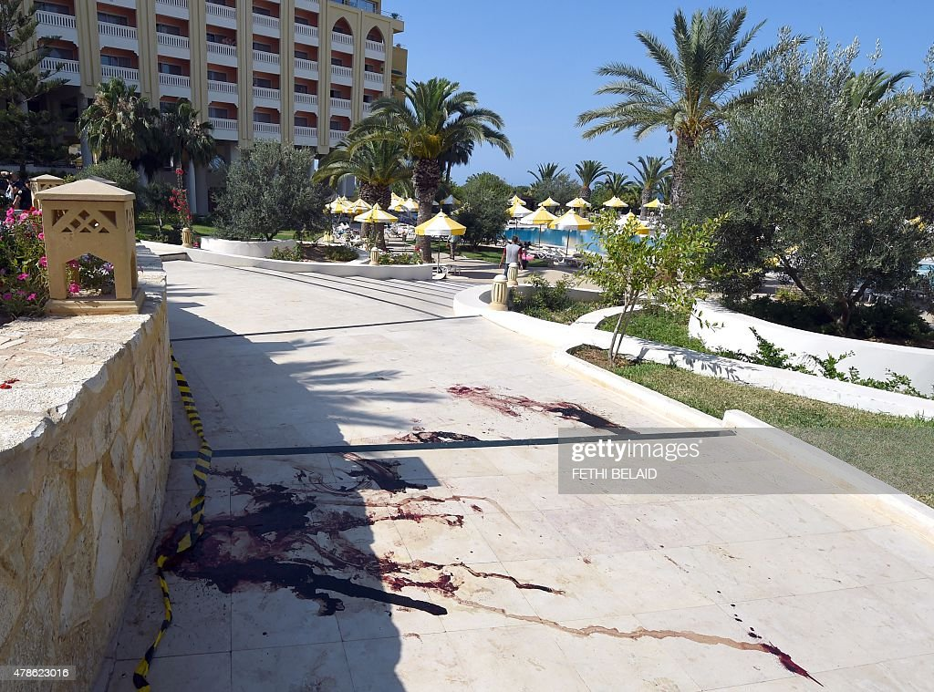 A blood stain covers the ground in the resort town of Sousse a popular tourist destination 140 kilometres south of the Tunisian capital on June 26...