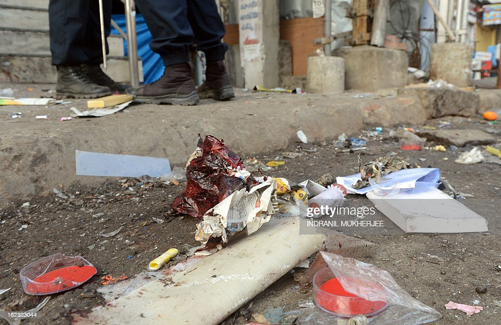 A blood stained newspaper lies at one of the blast sites at Dilsukh Nagar in Hyderabad on February 22, 2013. India hunted for perpetrators of twin bomb attacks that killed 14 people and wounded dozens more near a cinema and a bus stand in a busy neighbourhood in the city of Hyderabad. The bombings, the first to hit India since 2011, hit a mainly Hindu district in Hyderabad, a hub of India's computing industry which hosts local offices of Google and Microsoft among others and which has a large Muslim population. AFP PHOTO/Indranil MUKHERJEE