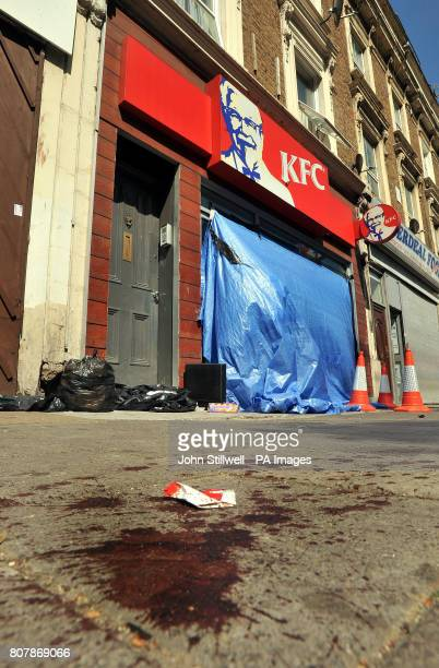 A blood stained pavement outside a KFC fast food outlet after a man was shot outside the shop in Harrow Road west London early this morning