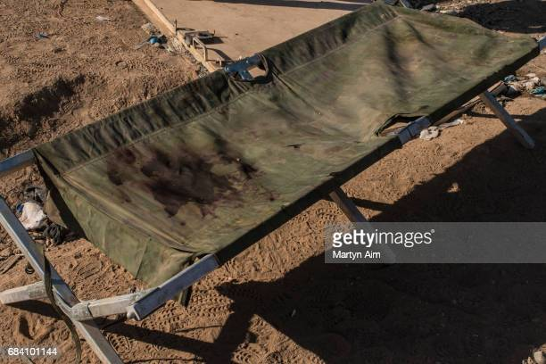 A blood stained stretcher at a field hospital in alSamah a district near Mosul northern Iraq