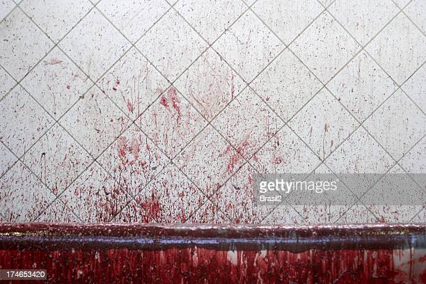 Blood staining on white tiled wall