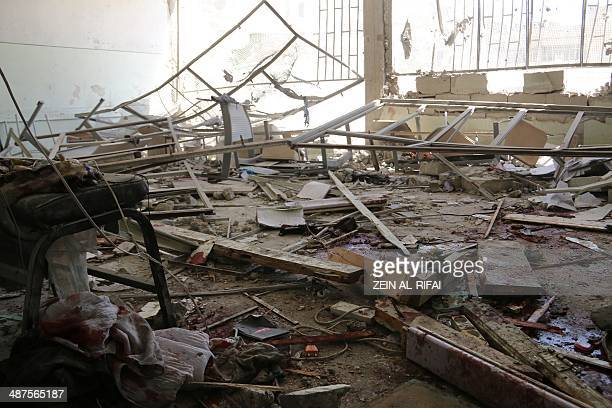 Blood stains are seen in a destroyed classroom at the Ain Jalout school following reported air strikes by Syrian government forces in the Ansari...