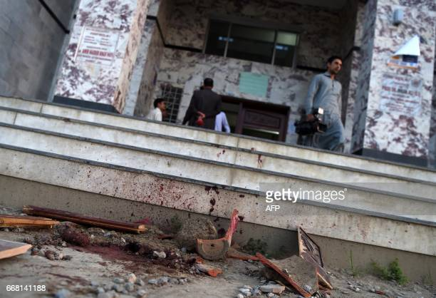 TOPSHOT Blood stains are seen on a wall and the ground at a hostel at Abdul Wali Khan university at the site of where students beat to death a...