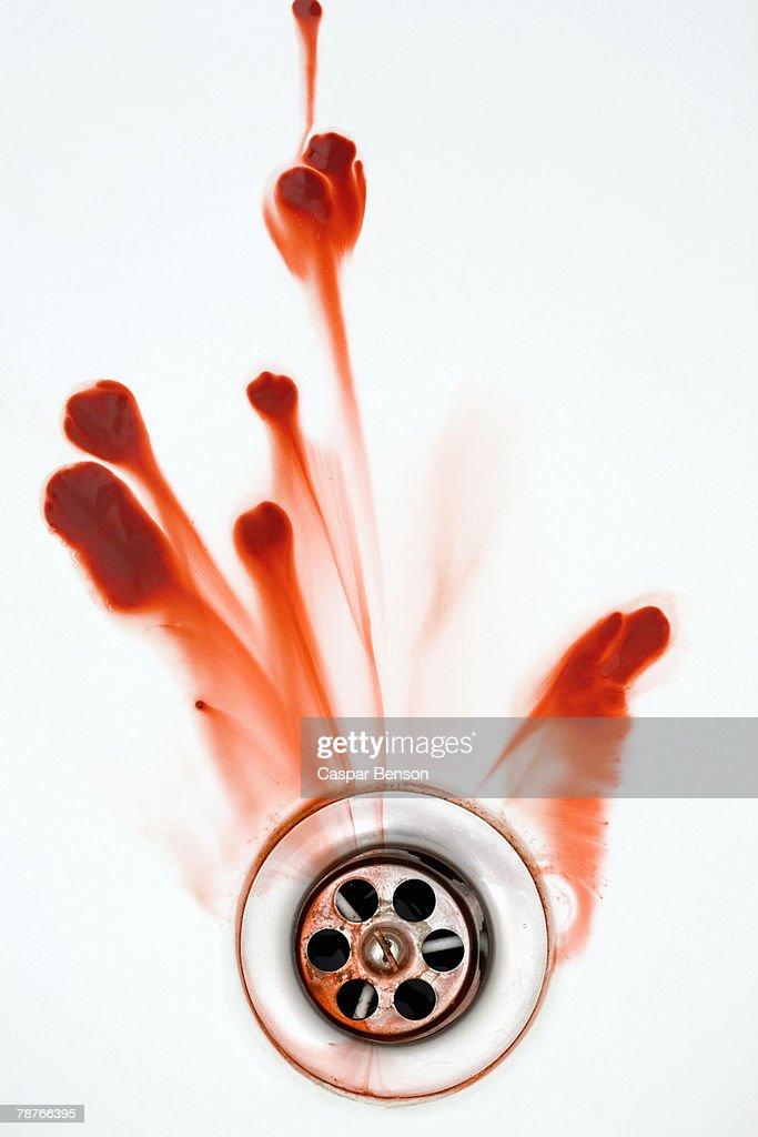 Blood washing down a plughole