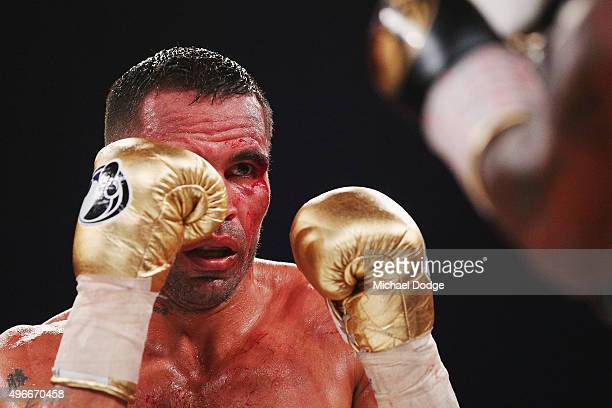 A bloodied Anthony Mundine of Australia looks on in his bout against Charles Hatley of the USA at The Melbourne Convention and Exhibition Centre on...