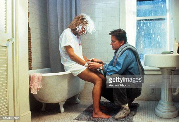 A bloodied Glenn Close is tended to by Michael Douglas in a scene from the film 'Fatal Attraction' 1987