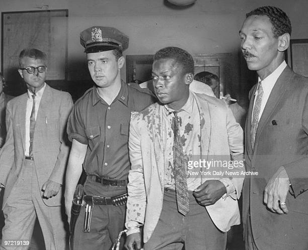 A bloodied Miles Davis with attorney Harold Lovette and patrolman Gerald Kilduff in the 54th Street Precinct after Davis was arrested for assault