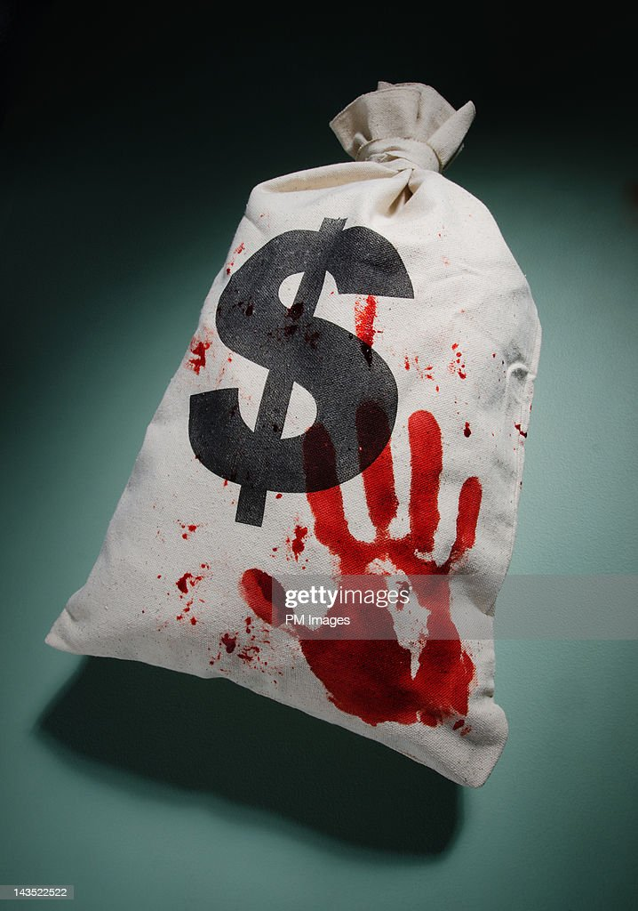 Bloodied money bag : Stock Photo