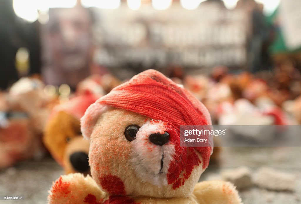 Bloodied teddy bears are seen during a demonstration against Russian military operations in Syria during a visit by Russian President Vladimir Putin to the German federal Chancellery on October 19, 2016 in Berlin, Germany. The leaders of Russia, Ukraine, France and Germany, known as the Normandy Four, met in Berlin to discuss implementation of the peace plan known as the Minsk Protocol, a roadmap for resolving the conflict in Ukraine after Russian forces invaded in 2014 and annexed the peninsula of Crimea. The United States has threatened renewed sanctions on Russia if the country did not either implement the plan in the coming months or arrive at a plan on how to do so.
