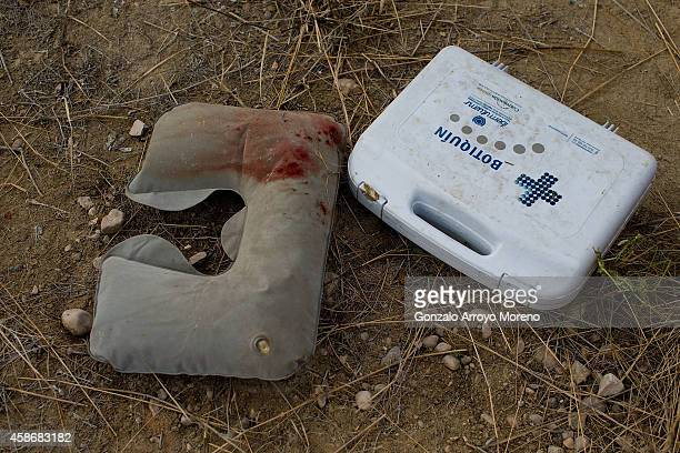 A bloodstained pillow remains close to a firstaid kit around the crashed bus in which 13 people died on November 9 2014 in Venta del Olivo at Murcia...