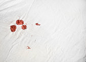 Bloodstains on a white sheet