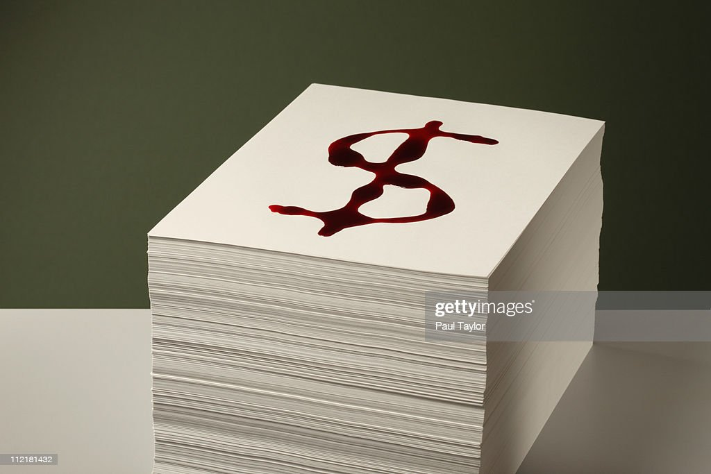 Bloody Dollar sign on Paper Stack : Stock Photo