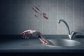 Bloody hand in kitchen sink, Halloween concept