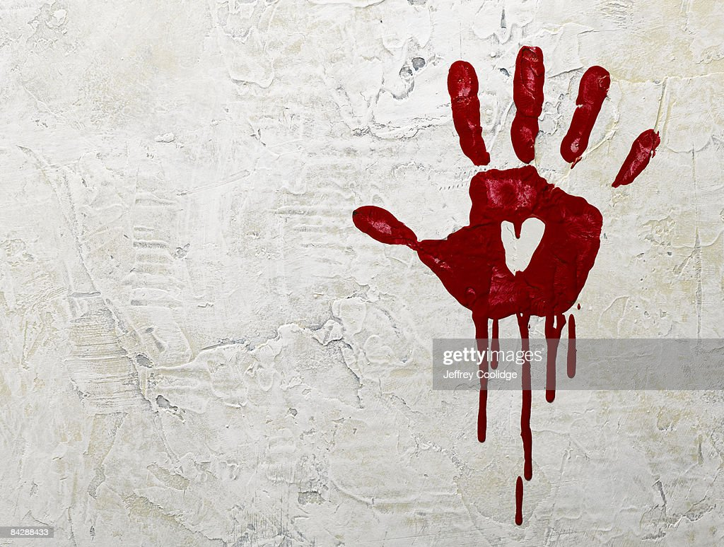 bloody hand print on wall : Foto stock
