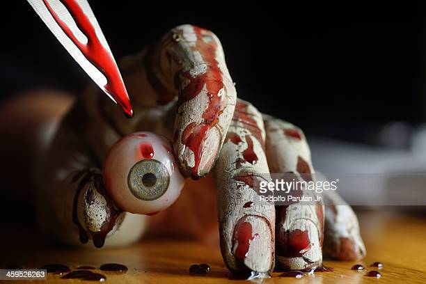 Bloody hand with eyeball