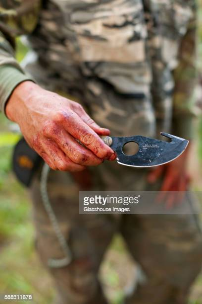 Bloody Hand With Hunting Knife