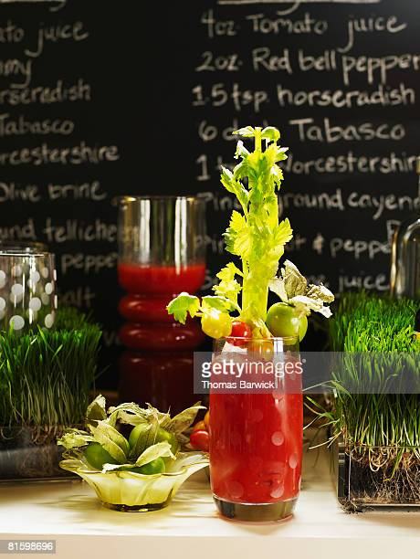 Bloody mary with tomatillo, cherry tomato and celery garnish