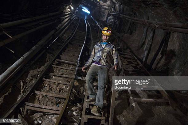 A miner descends a flight of steps into a mine shaft at the Mogok Pride mine in Mogok Mandalay Myanmar on Monday March 14 2016 In a remote region of...