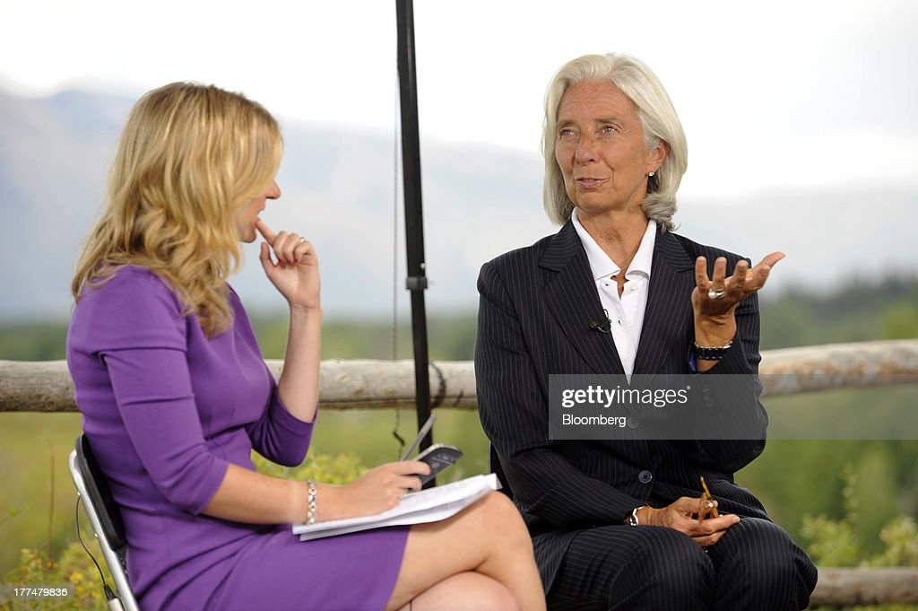Bloomberg News reporter Sarah Eisen, left, interviews <a gi-track='captionPersonalityLinkClicked' href=/galleries/search?phrase=Christine+Lagarde&family=editorial&specificpeople=566337 ng-click='$event.stopPropagation()'>Christine Lagarde</a>, managing director of the International Monetary Fund (IMF), at the Jackson Hole economic symposium, sponsored by the Kansas City Federal Reserve Bank at the Jackson Lake Lodge in Moran, Wyoming, U.S., on Friday, Aug. 23, 2013. The U.S. central banks bond buying is a less potent tool for stimulating growth than policy makers believe, two economists said in a paper released today at a Federal Reserve conference. Photographer: Price Chambers/Bloomberg via Getty Images