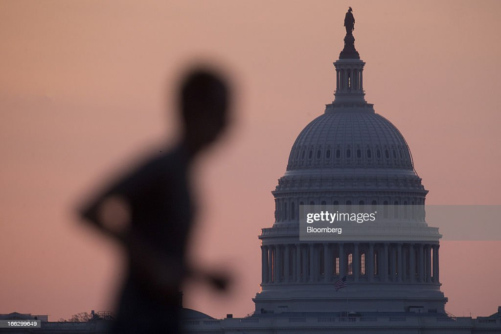 Bloomberg Photo Service 'Best of the Week': A man jogs past the U.S. Capitol in Washington, D.C., U.S., on Tuesday, April 9, 2013. Less than a week after job-creation figures fell short of expectations and underscored the U.S. economy's fragility, President Barack Obama will send Congress a budget that doesn't include the stimulus his allies say is needed and instead embraces cuts in an appeal to Republicans. Photographer: Andrew Harrer/Bloomberg via Getty Images
