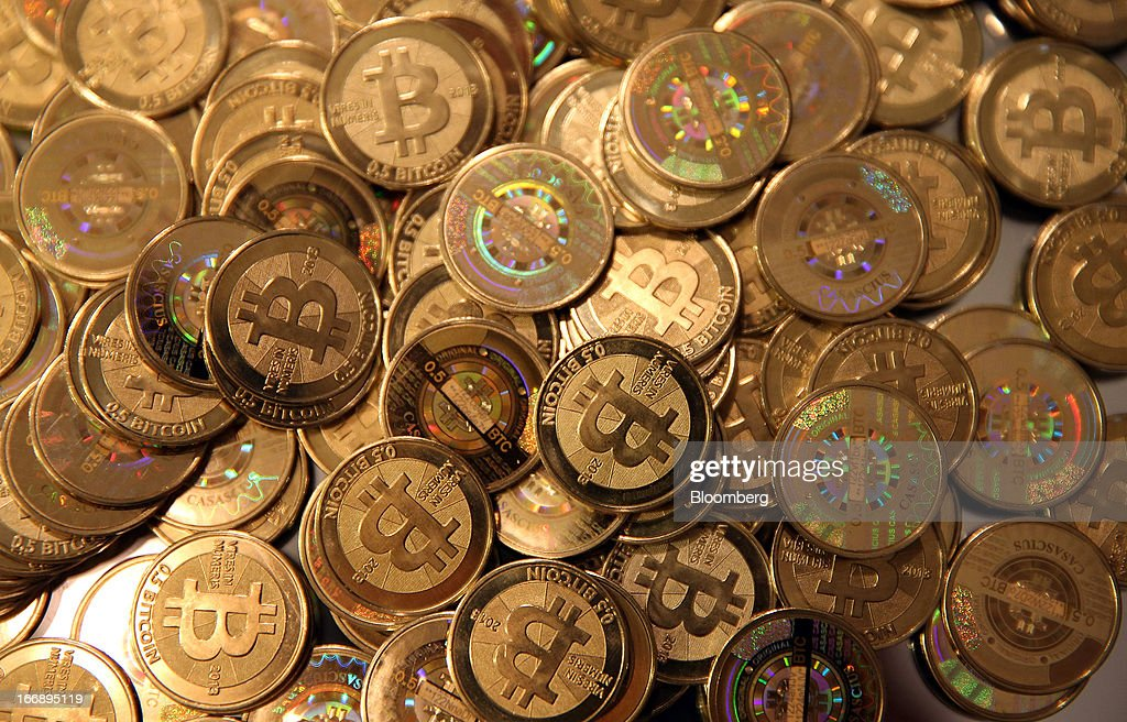 Bloomberg Photo Service 'Best of the Week': A pile of Bitcoins that were just made are arranged for a photograph in Sandy, Utah, U.S., on Friday, April 12, 2013. Created four years ago by a person or group using the name Satoshi Nakamoto, Bitcoin is a virtual currency that can be used to buy and sell a broad range of items -- from cupcakes to electronics to illegal narcotics. Photographer: George Frey/Bloomberg via Getty Images