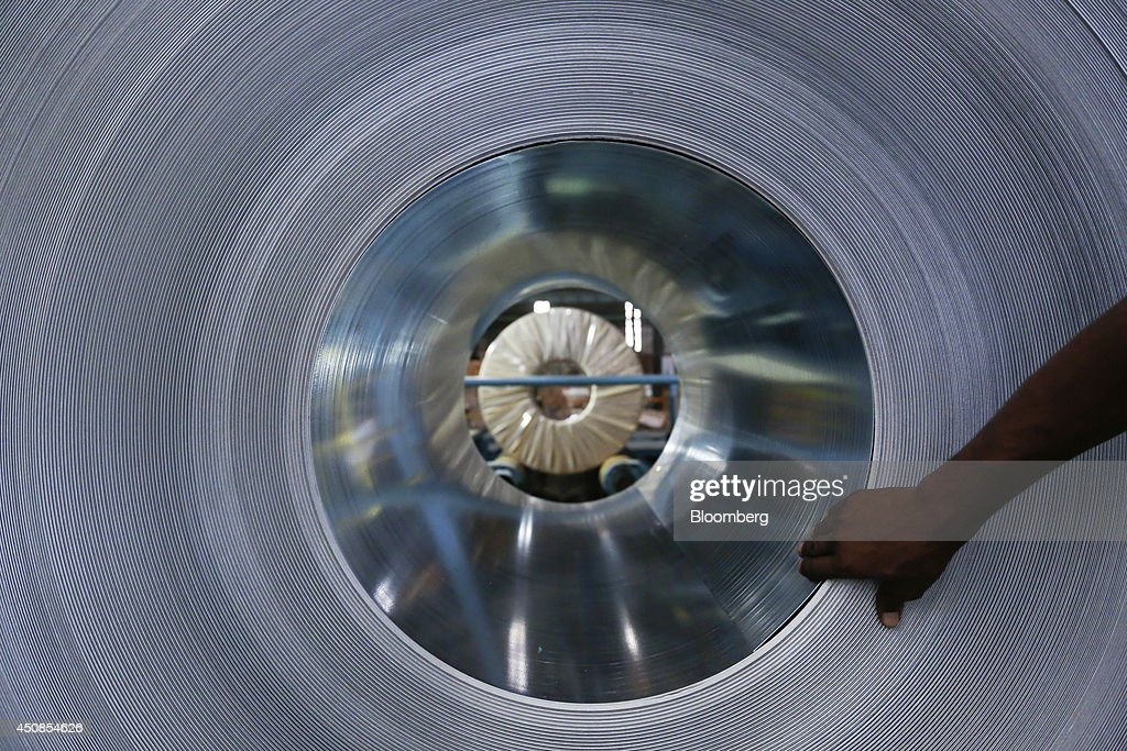 Bloomberg Photo Service 'Best of the Week' An employee prepares to package a coil of galvanized steel at the manufacturing facility of Uttam Galva...